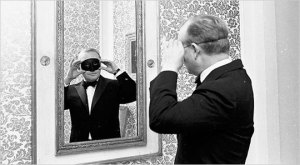 Truman Capote, modeling the mask for his famous Black and White Ball, 1966 Photo taken from Jewels du Jour